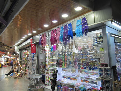 Market in Turkey. Belly dancing costumes are quite popular.