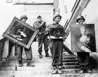 MFAA Officer James Rorimer supervises U.S. soldiers recovering looted paintings from Neuschwanstein Castle (Photo credit: NARA / Public Domain)